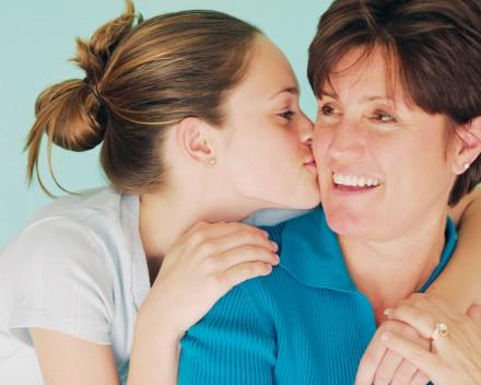 Teen Daughter Kissing Mother
