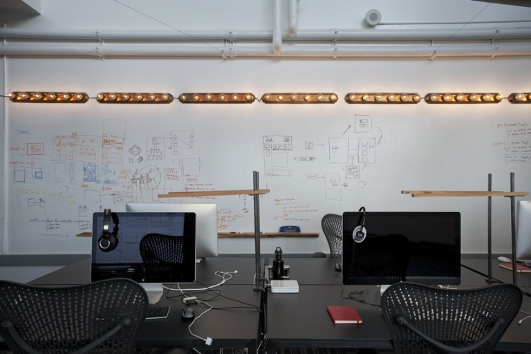 Unique lighting adds an offbeat element to the sleek, functional workspace.