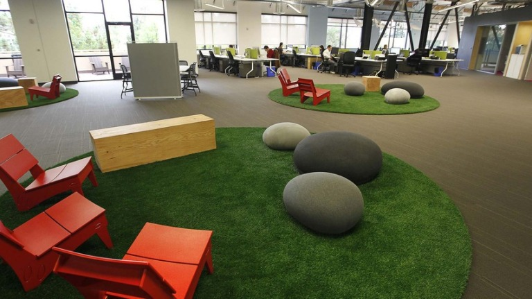 "Skype's open concept work area takes its design cues from the great outdoors; the slate-colored ""rocks"" are actually cushions."