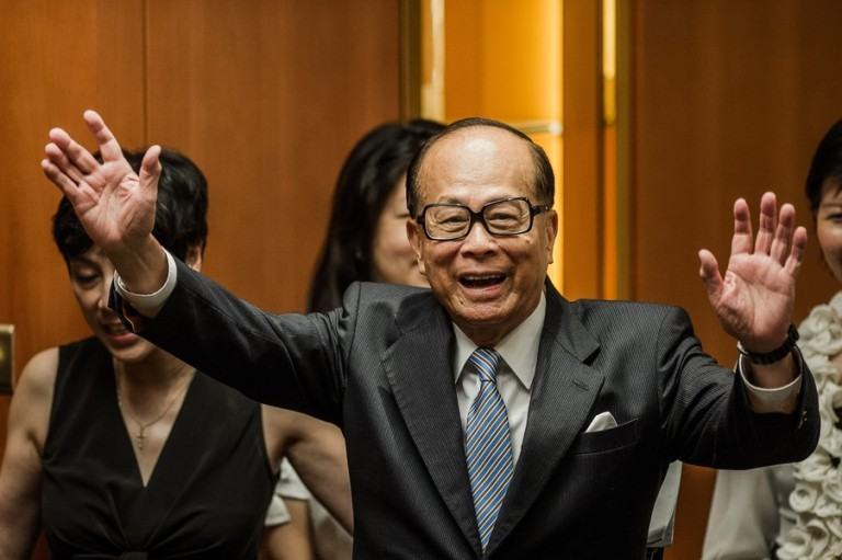 Asia's richest man Li Ka-shing waves as