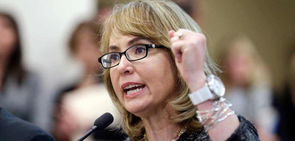 FILE - In this Jan. 28, 2014, file photo, former Arizona Congresswoman Gabrielle Giffords pumps her fist as she testifies before a Washington state House panel in Olympia, Wash. Giffords will begin a nine-state tour in Maine on Tuesday, Oct. 14, 2014, where she will advocate for tougher gun laws that she says will help protect women and families. Giffords, who was severely wounded by a gunman in 2011, will seek to elevate the issue of gun violence against women and push for state and federal action to make it more difficult for domestic abusers to get a hold of firearms. (AP Photo/Elaine Thompson, File)